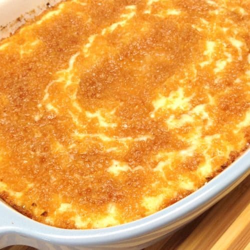 Cheesy Baked Cauliflower Mash in blue casserole dish