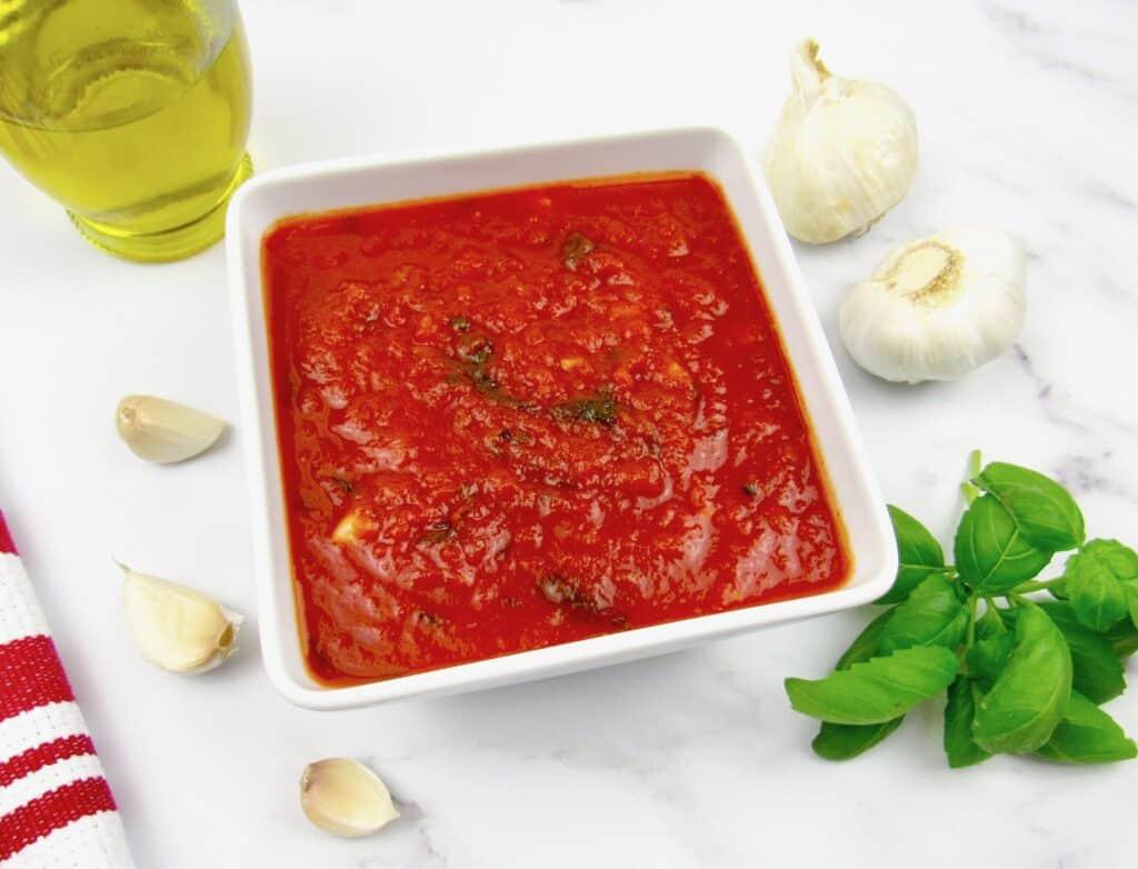 marinara sauce in white square bowl