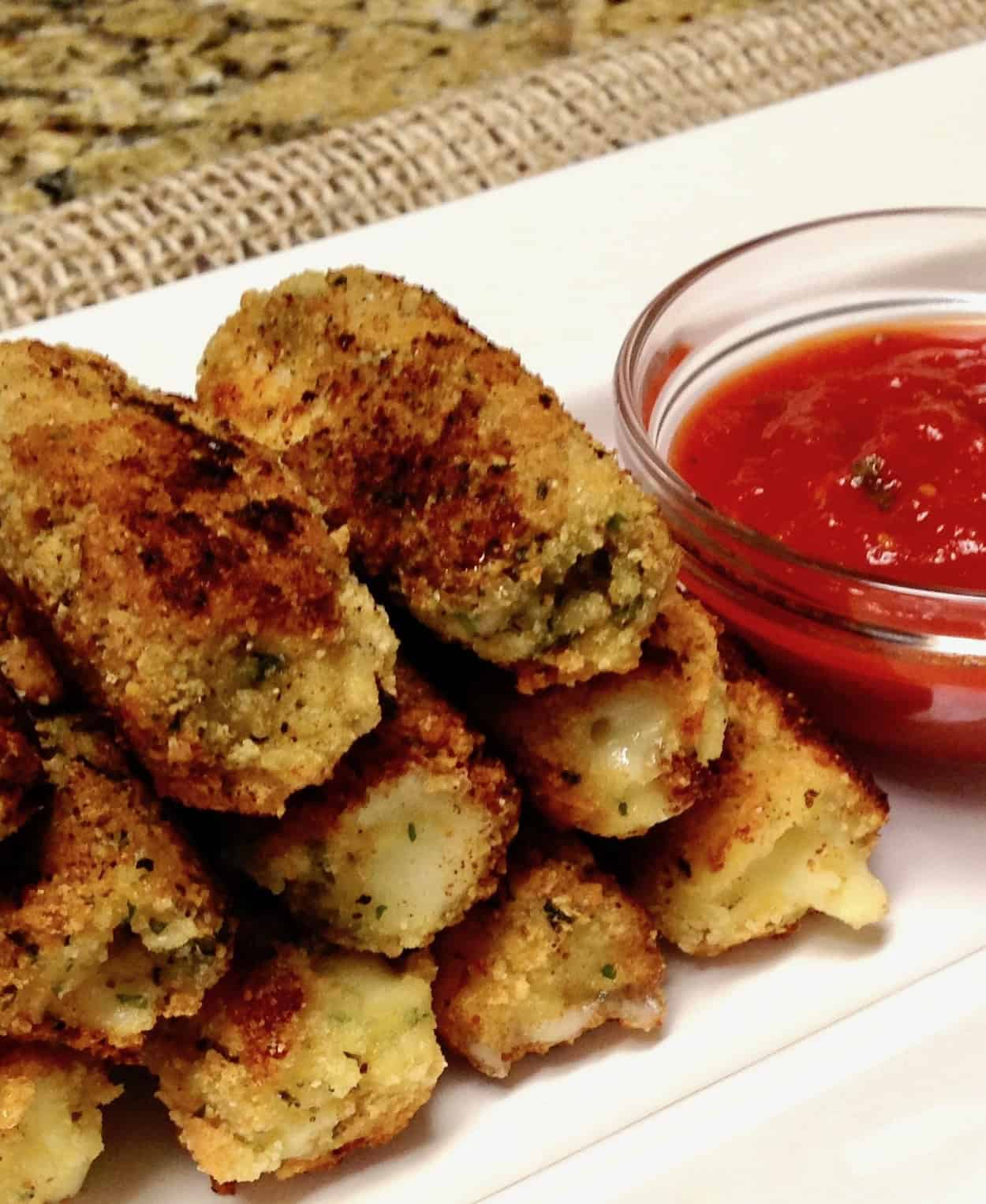 Keto/Low Carb/Gluten Free Mozarella Sticks on Serving Plate with Red Sauce
