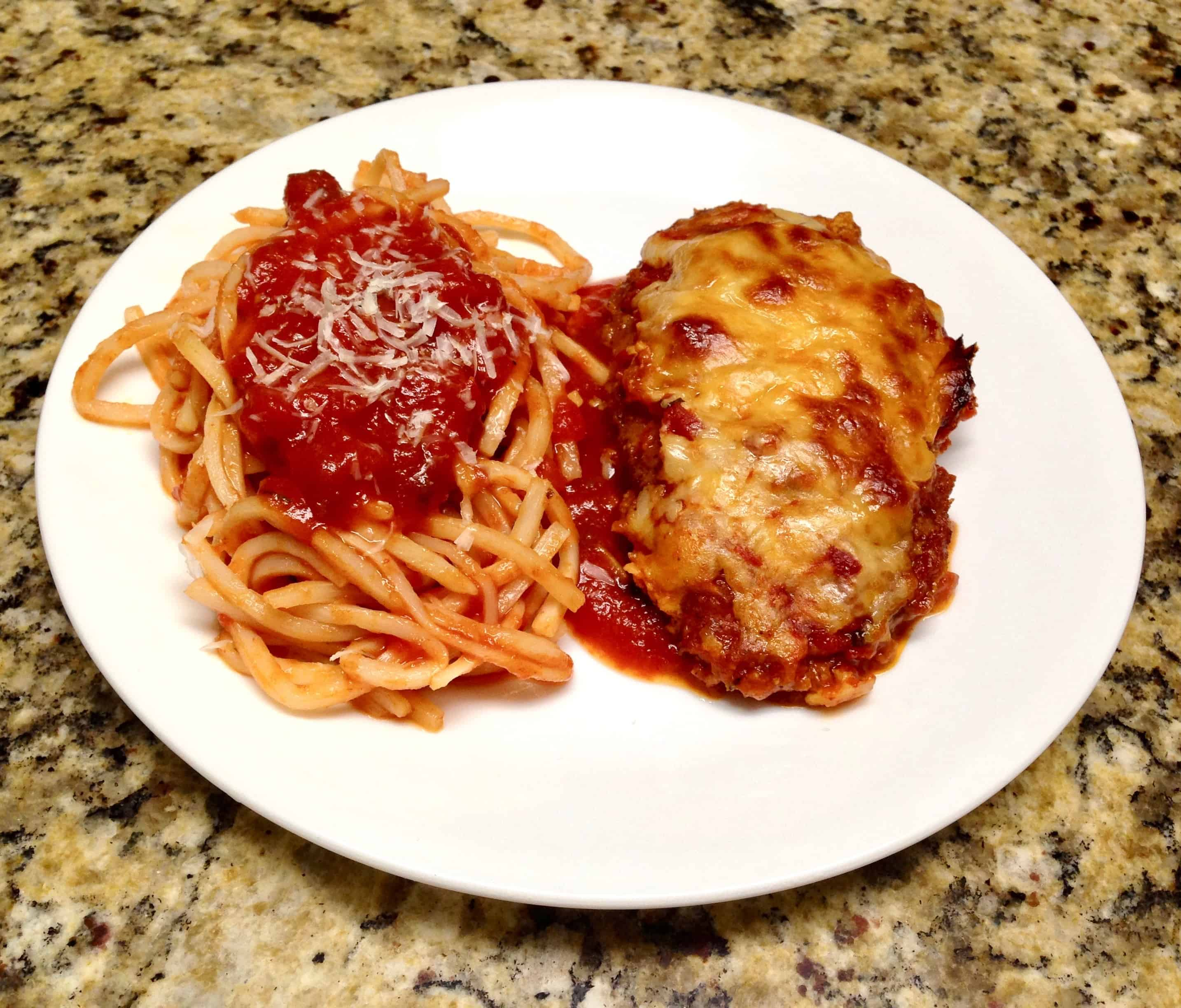 chicken parm on white plate with Palmini pasta with marinara