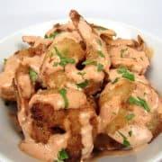 bang bang shrimp in bowl with sauce on top