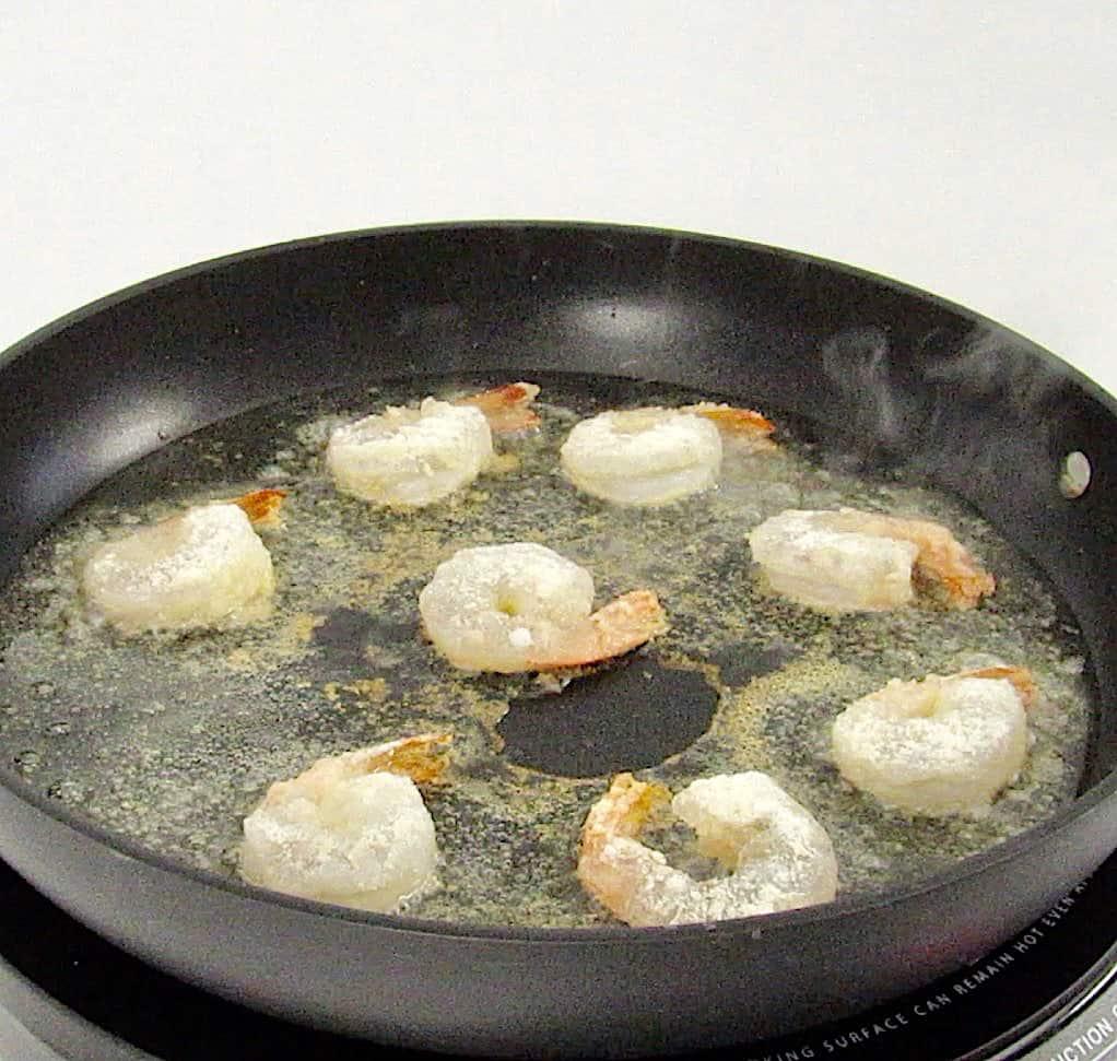 shrimp frying in skillet