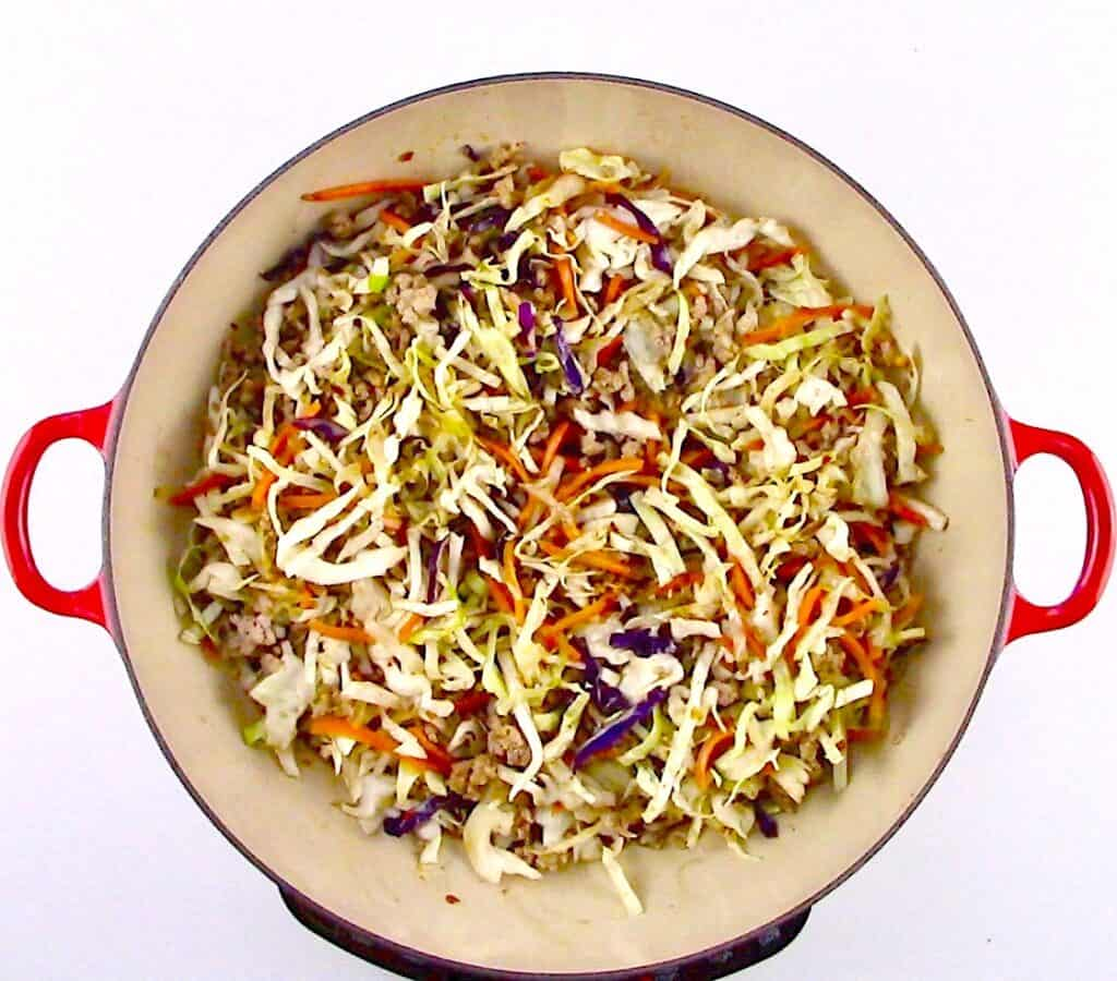 ground pork and slaw mix in pan
