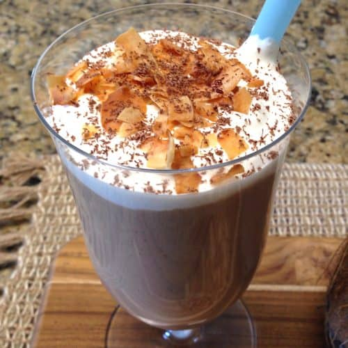 coconut shake in glass with toasted coconut on top