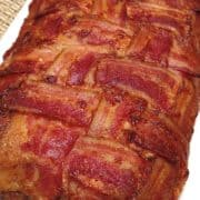 bacon wrapped meatloaf on white plate