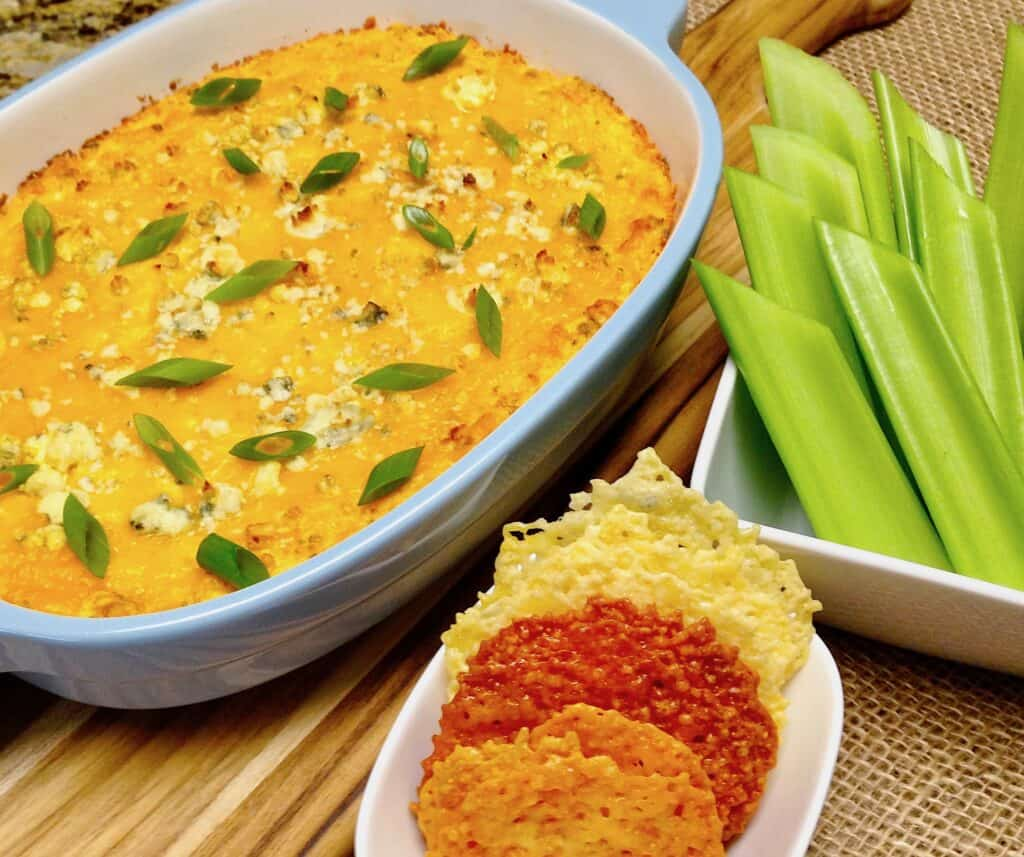 overhead view of baked chicken dip with crackers and celery on side