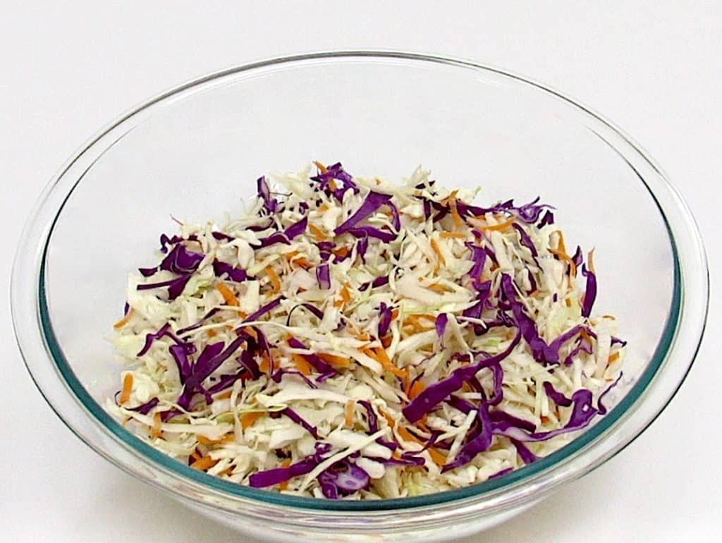 glass bowl of coleslaw mix