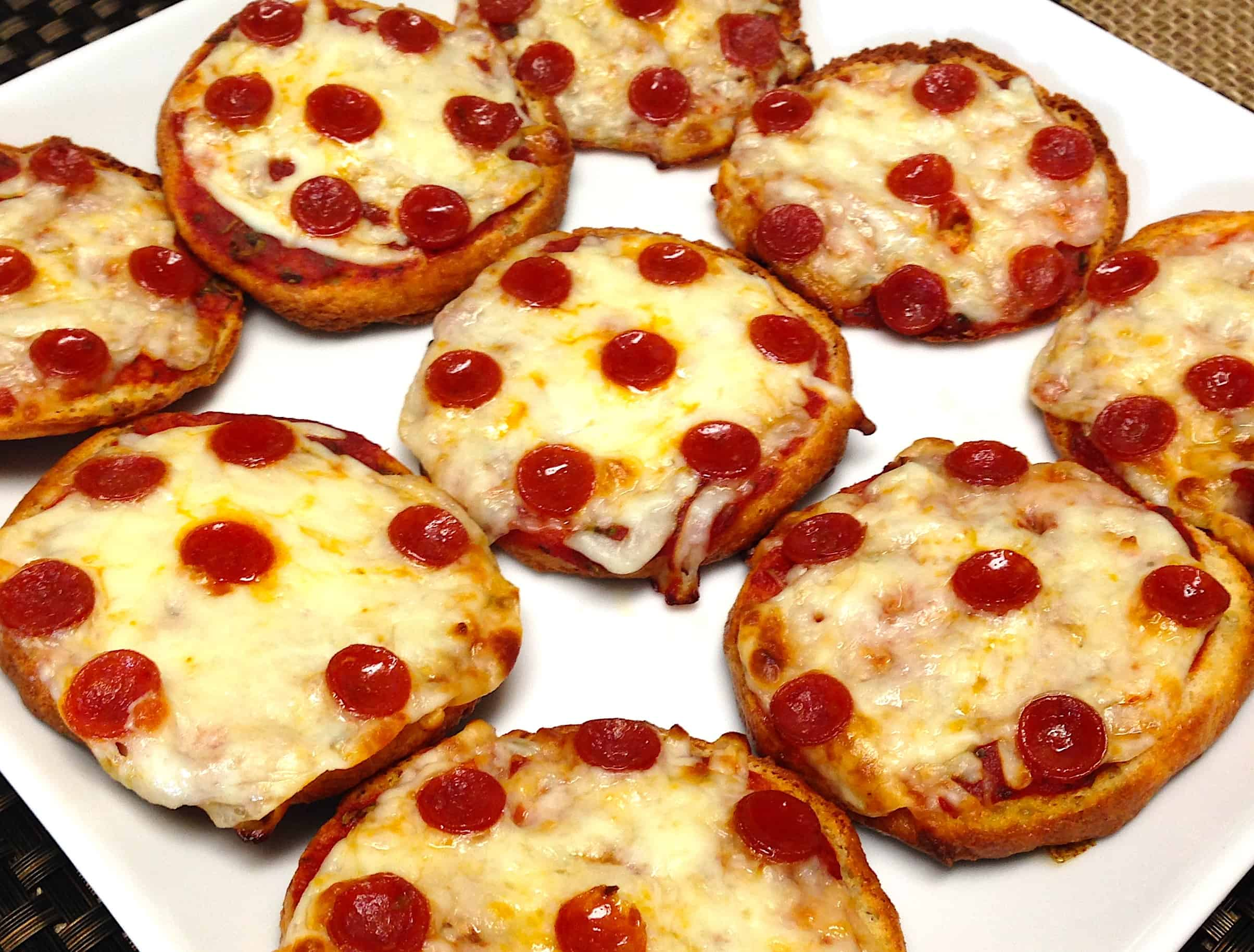 closeup of Pepperoni Pizza Bagels on white plate