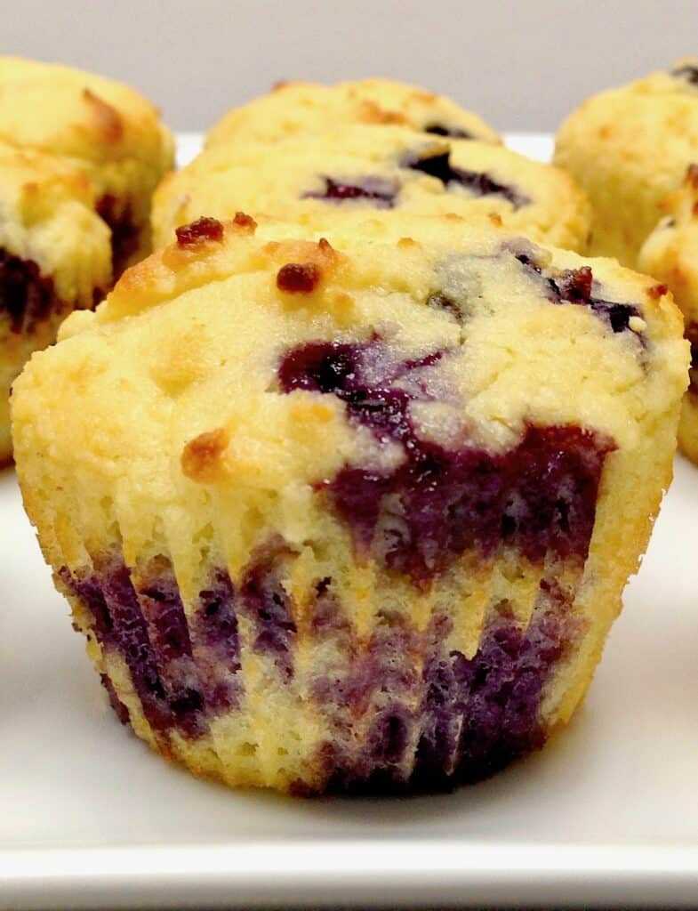 closeup of a blueberry muffin on white platter