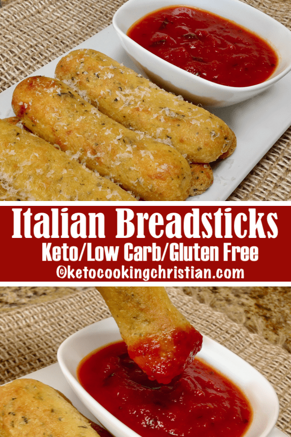 breadsticks with grated cheese over the top and marinara sauce in a bowl on the side