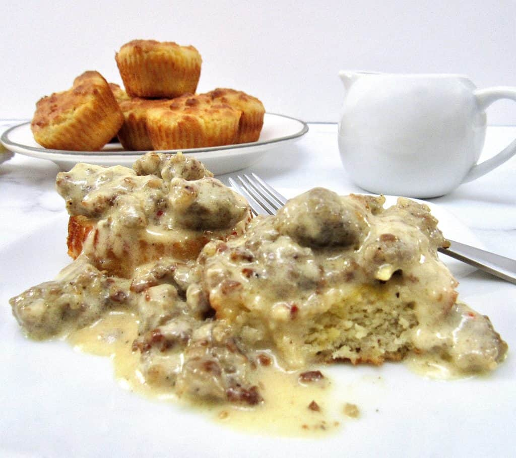 Biscuits and Gravy on plate with biscuits in background