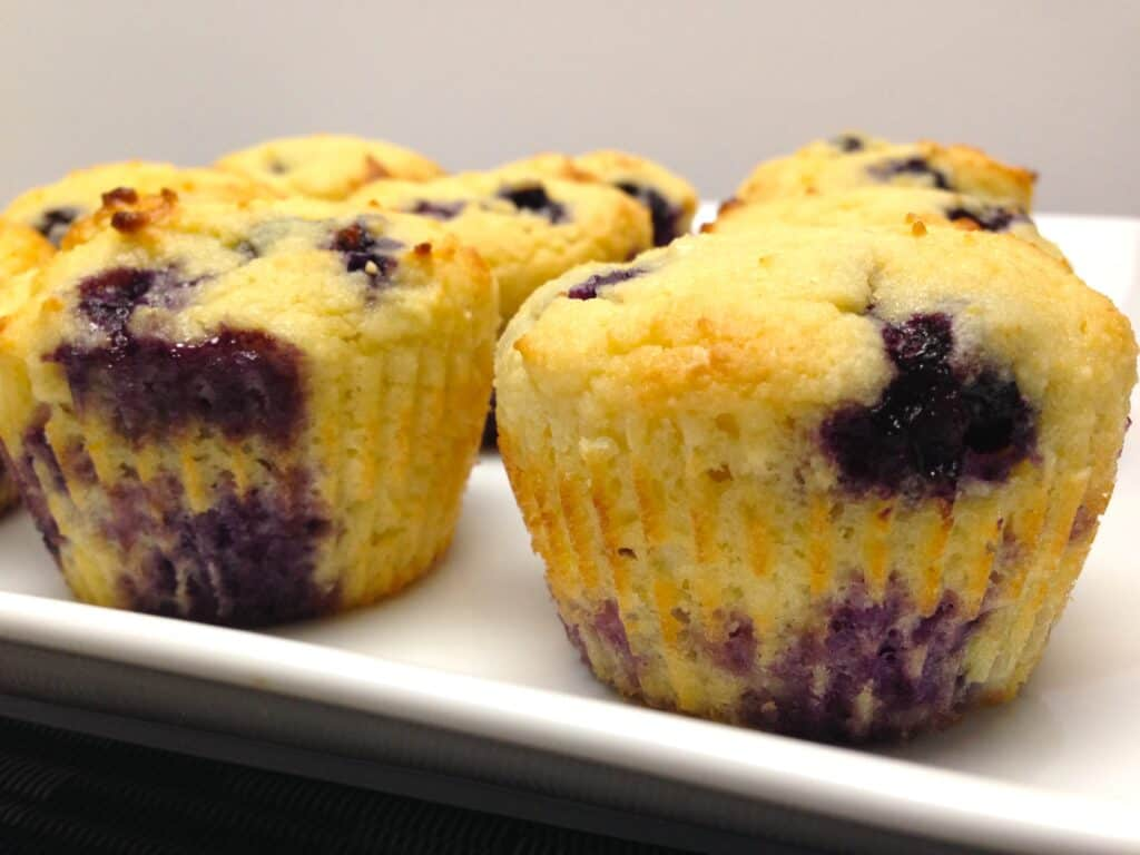 closeup of blueberry muffins on white plate