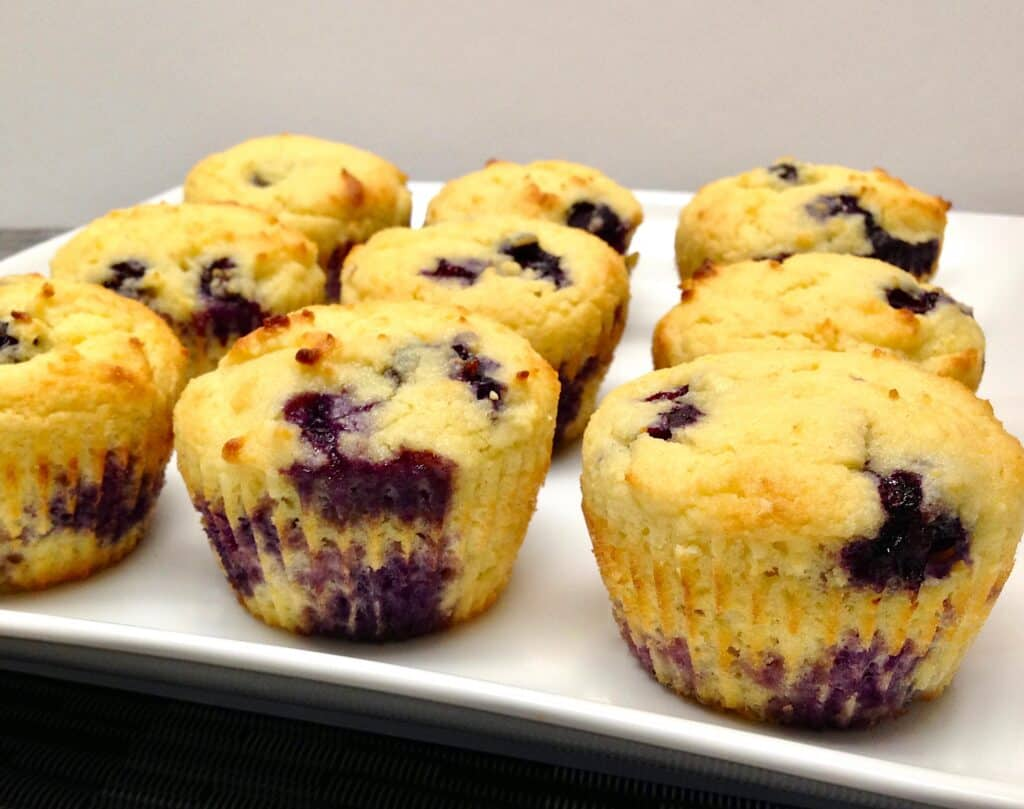 9 blueberry muffins on white square plate
