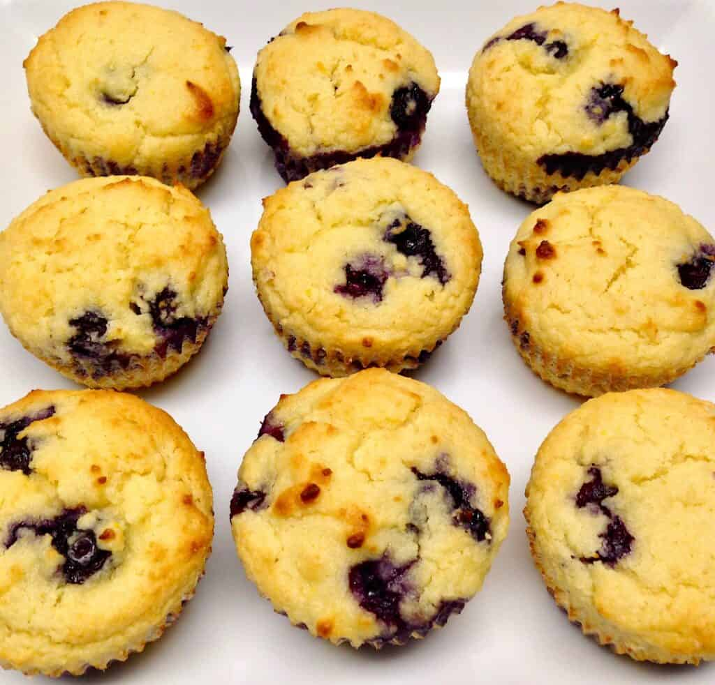 overhead view of blueberry muffins on white square plate