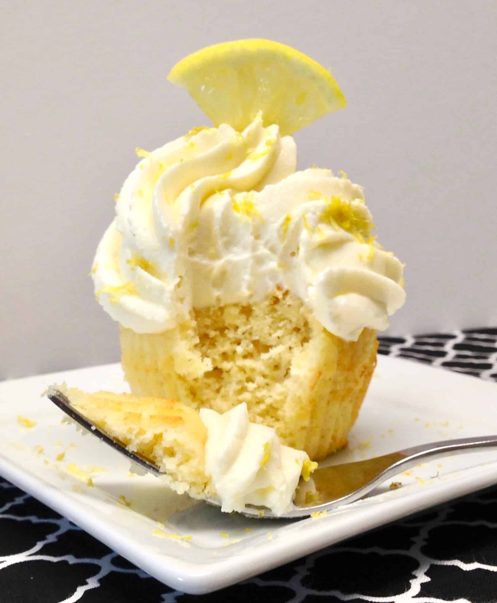 lemon frosted cupcake with bite taken out