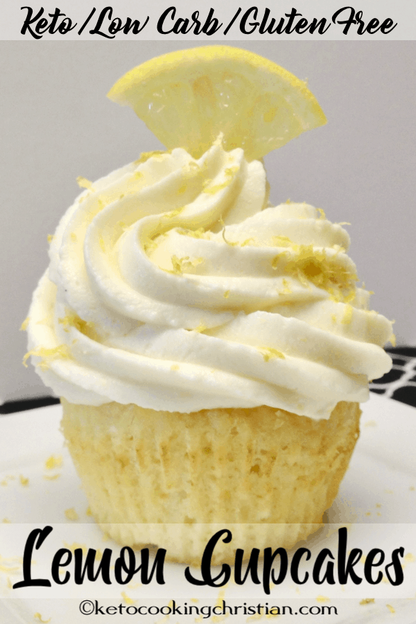 lemon cupcake with lemon frosting, lemon zest and a slice of lemon on top
