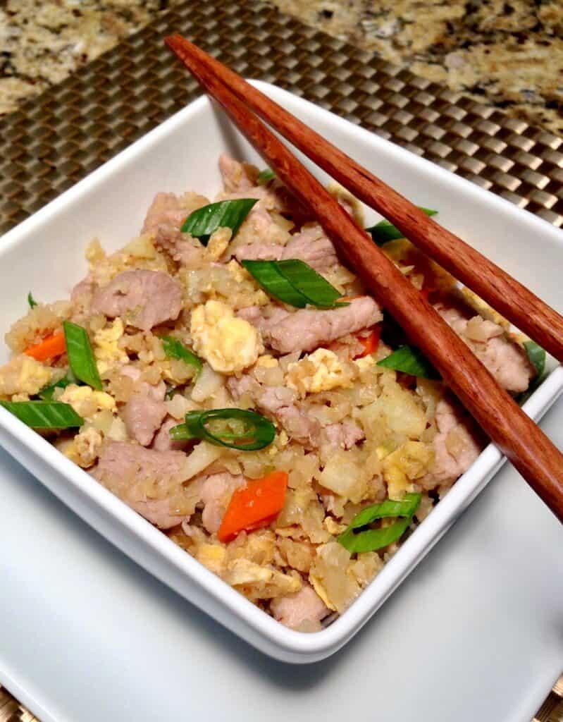 Pork Fried Cauliflower Rice in bowl with Chopsticks