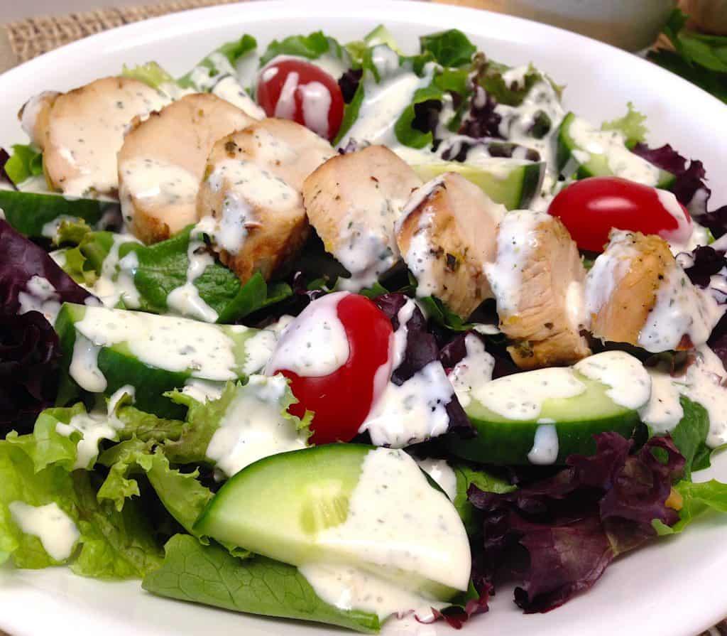 closeup of Creamy Garlic Italian Dressing over chicken salad