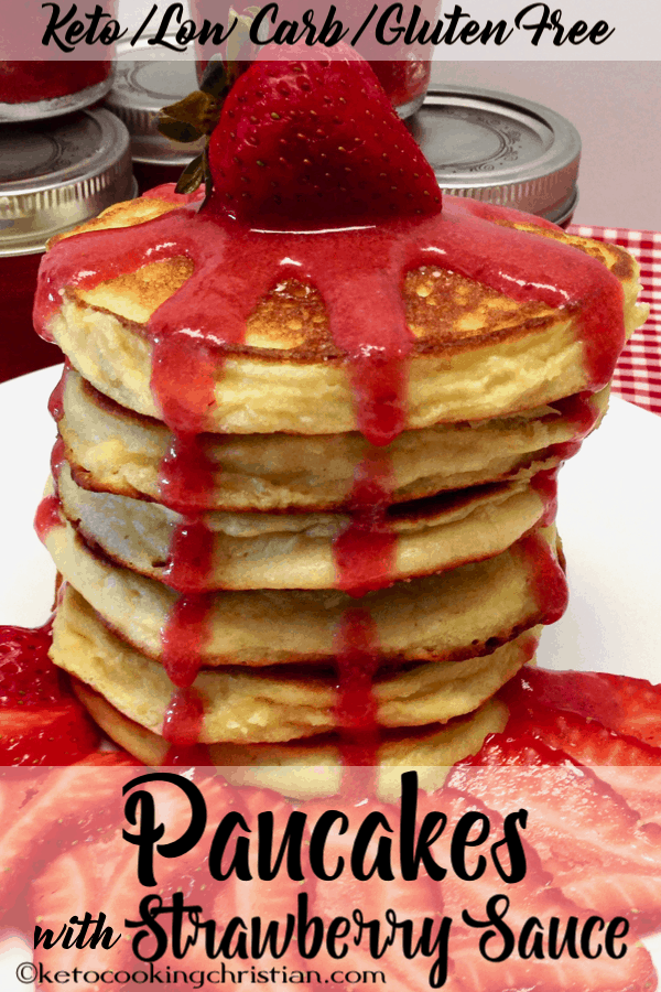 stack of pancakes with strawberry sauce over the top and dripping down all sides
