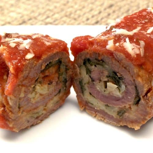 sliced braciole with marinara sauce on top
