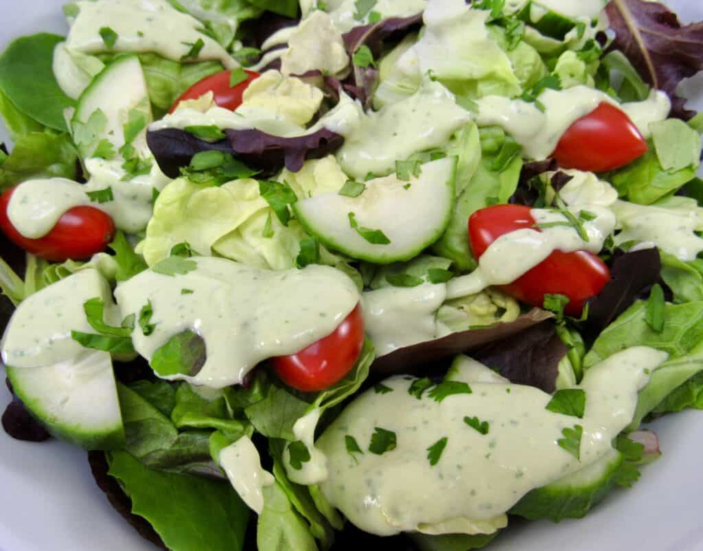 closeup of salad with avocado ranch on top
