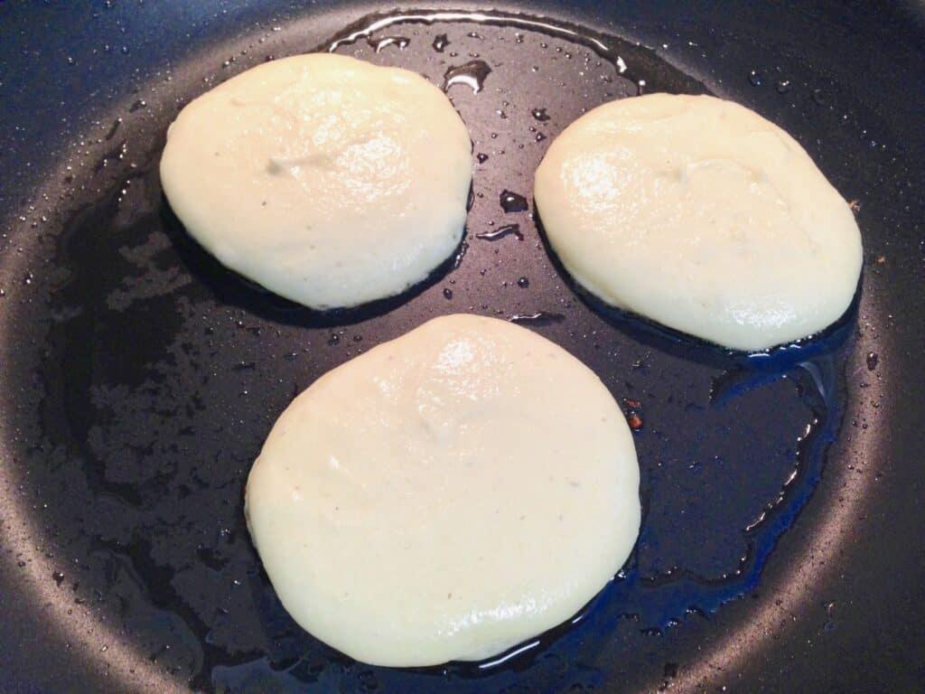 pancakes cooking in skillet