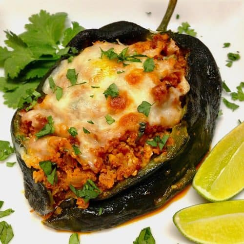 Stuffed Poblano pepper on white plate