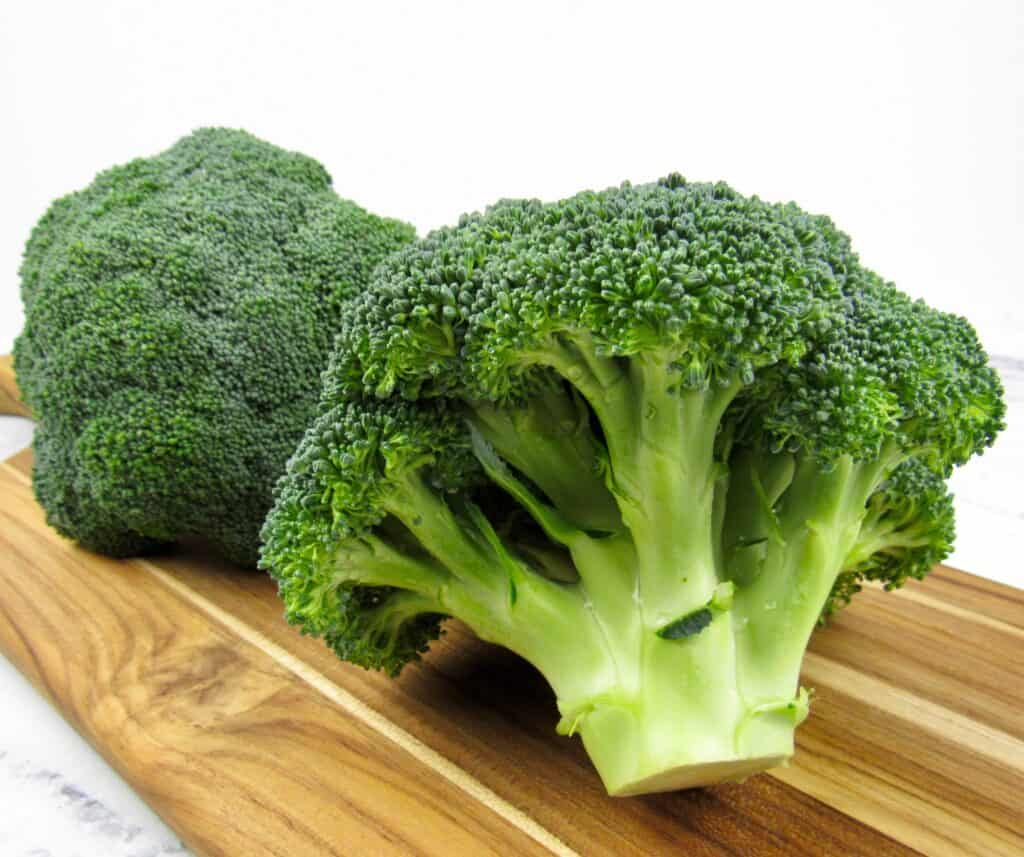 head of broccoli on cutting board