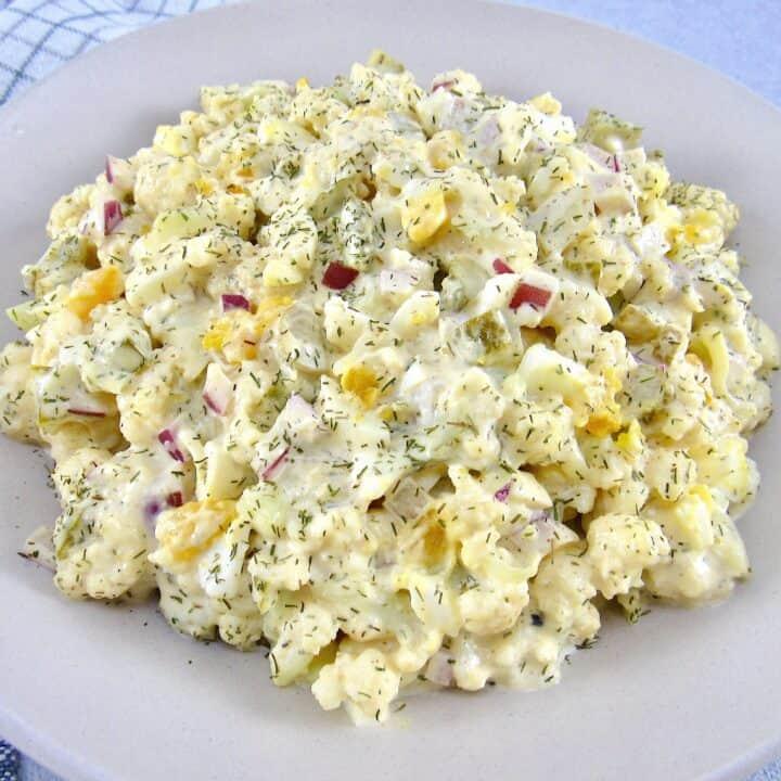 """Cauliflower """"Potato"""" Salad in beige bowl"""