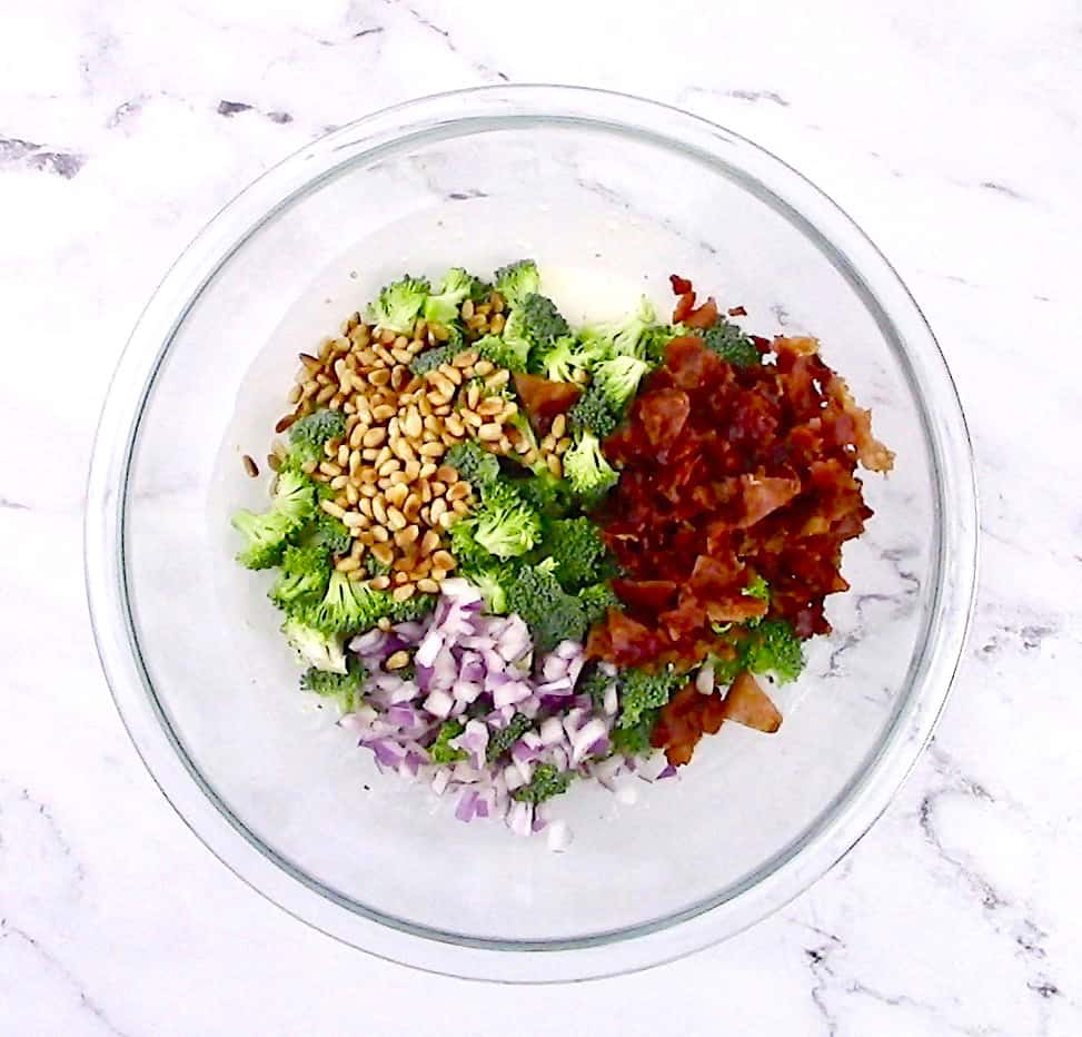 broccoli salad ingredients in glass bowl