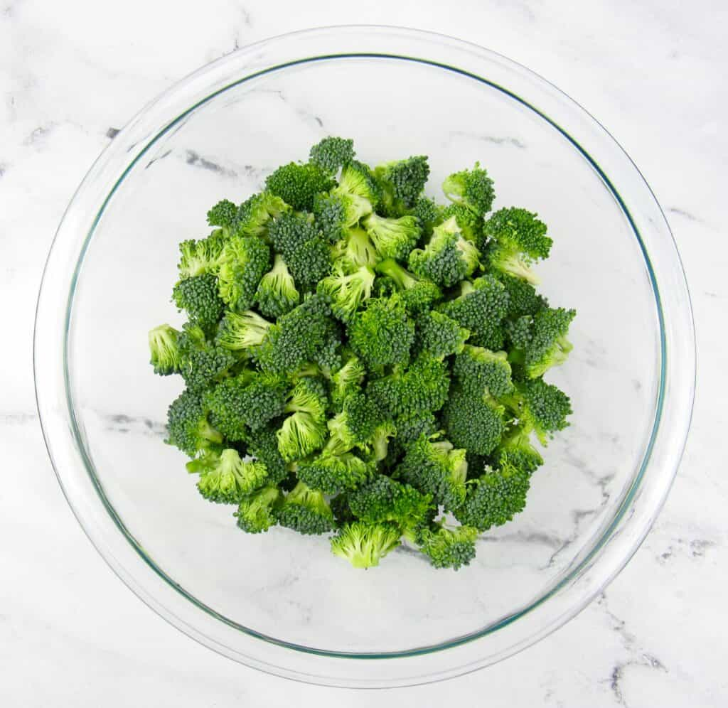 broccoli florets in glass bowl