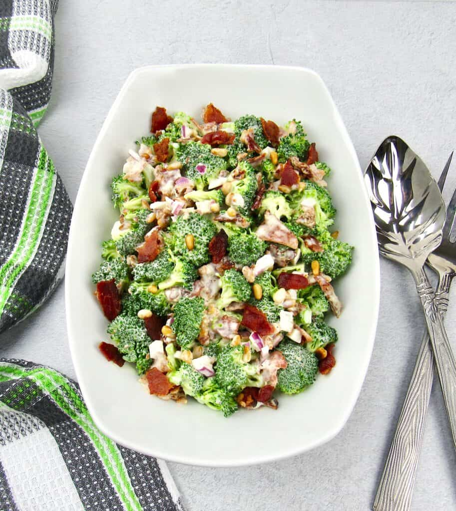 overhead view of broccoli salad in white bowl