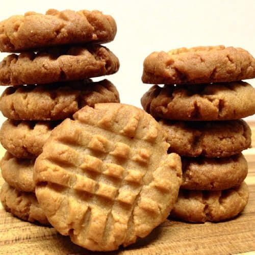 Keto Peanut Butter Cookies stacked on cutting board