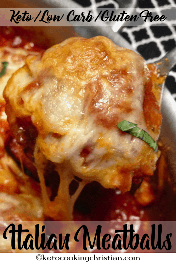 meatballs in a skillet with melted mozzarella cheese
