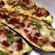 Closeup of Lasagna Stuffed Zucchini Boats with basil on top