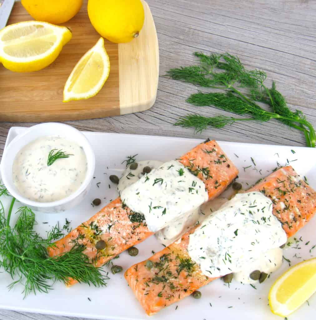overhead view of salmon with sauce on plate