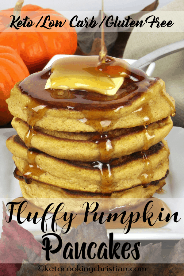 stack of fluffy pumpkin pancakes with pat of butter and maple syrup pouring over the top