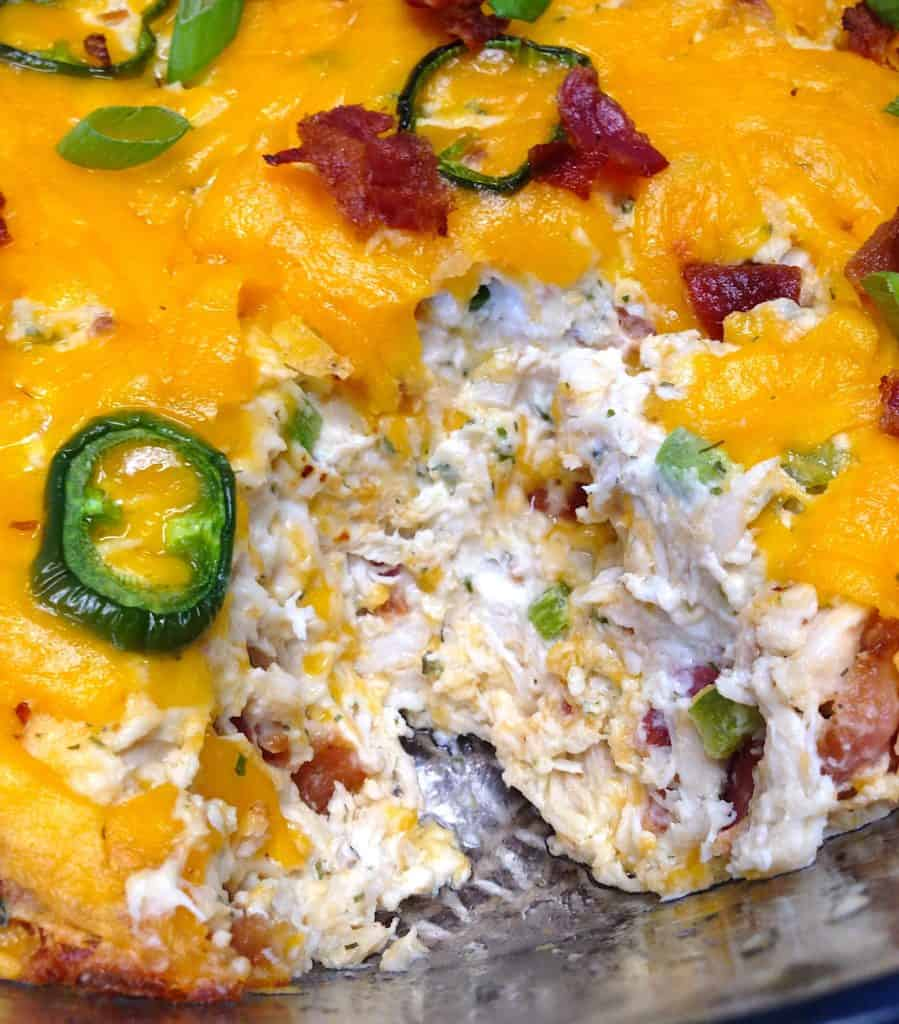 jalapeno popper chicken dip with scoop taken out