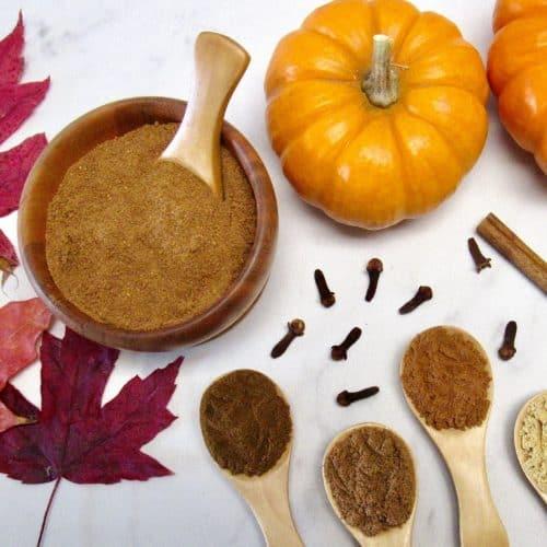 Pumpkin Pie Spice in wooden bowl with pumpkin in background