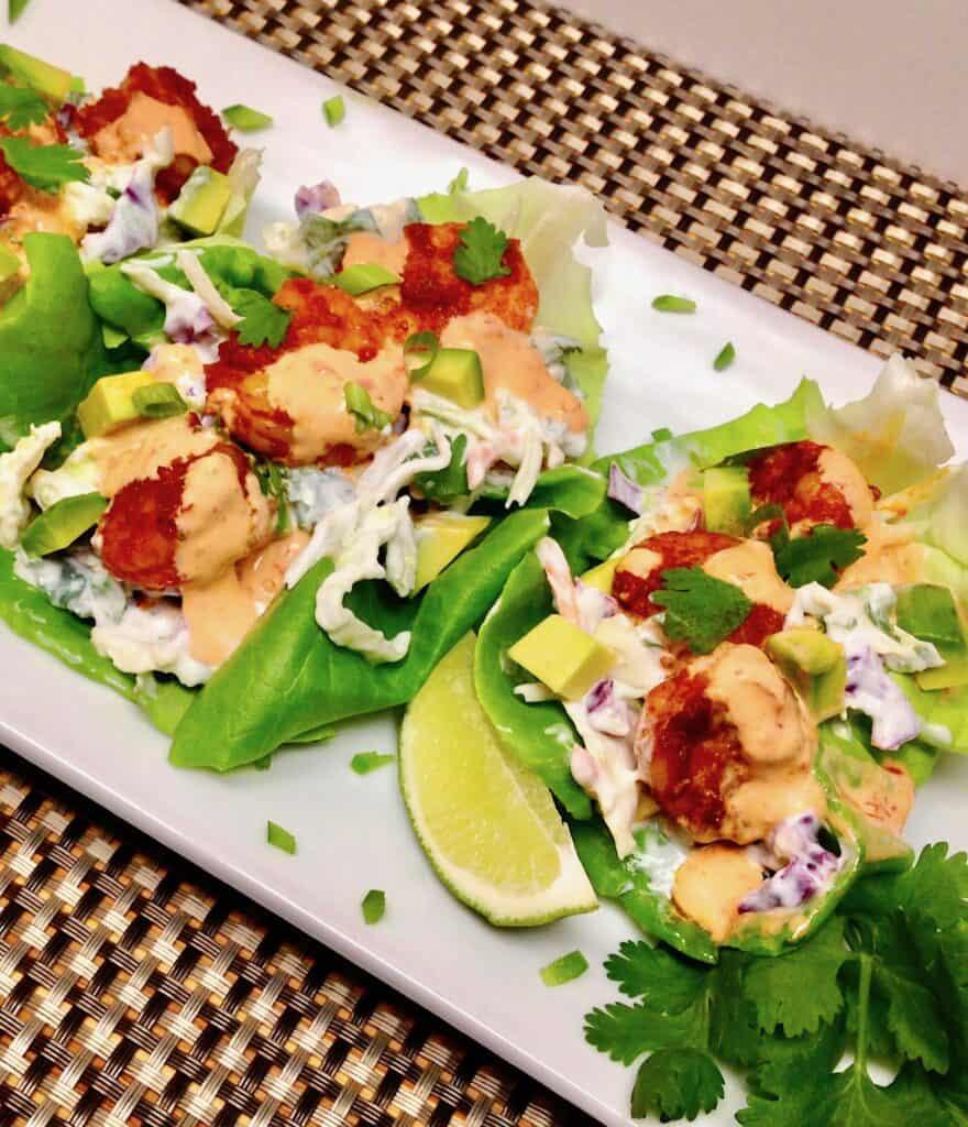 shrimp lettuce cups on white plate