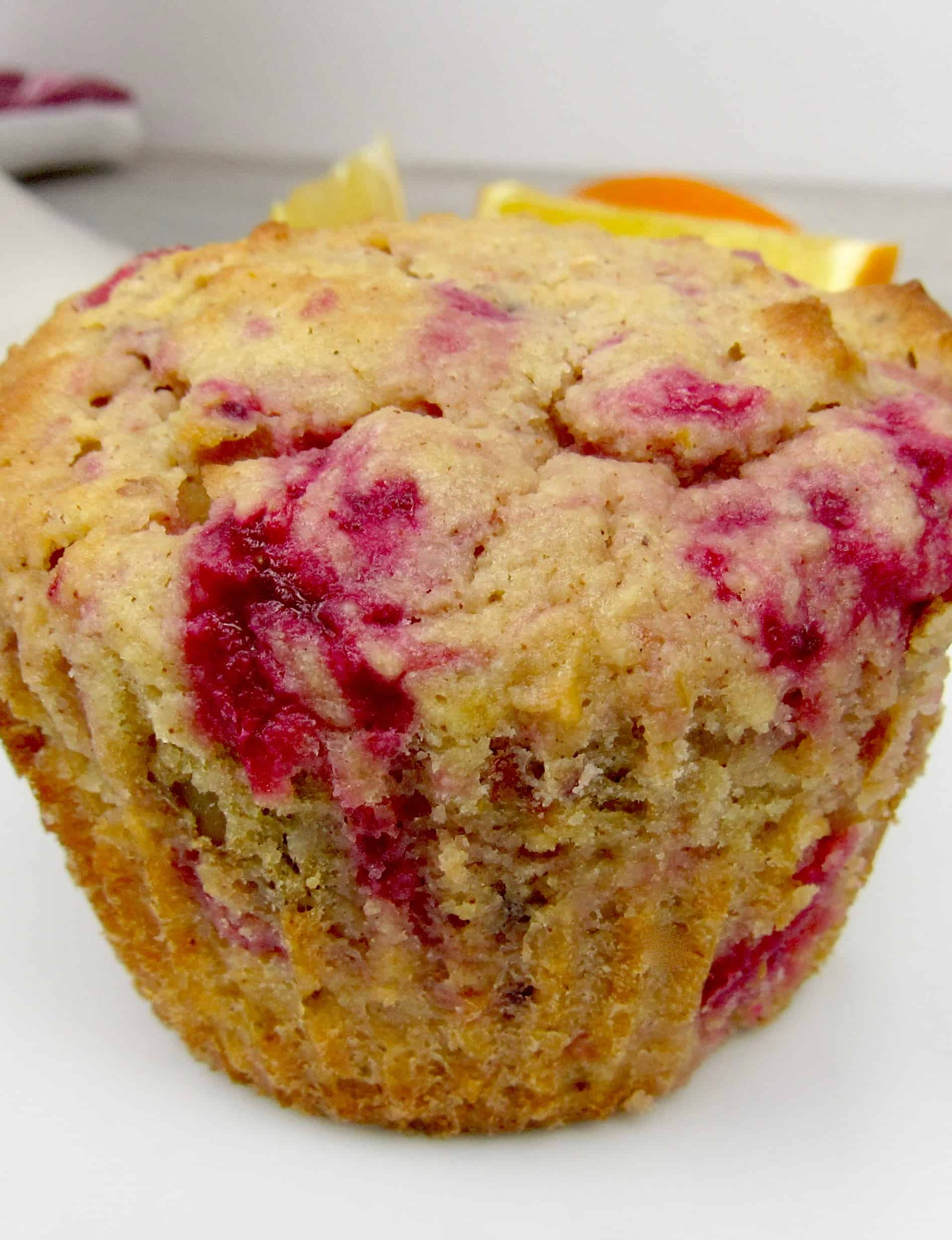 closeup of cranberry muffin on white plate