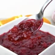 cranberry sauce being held up with spoon