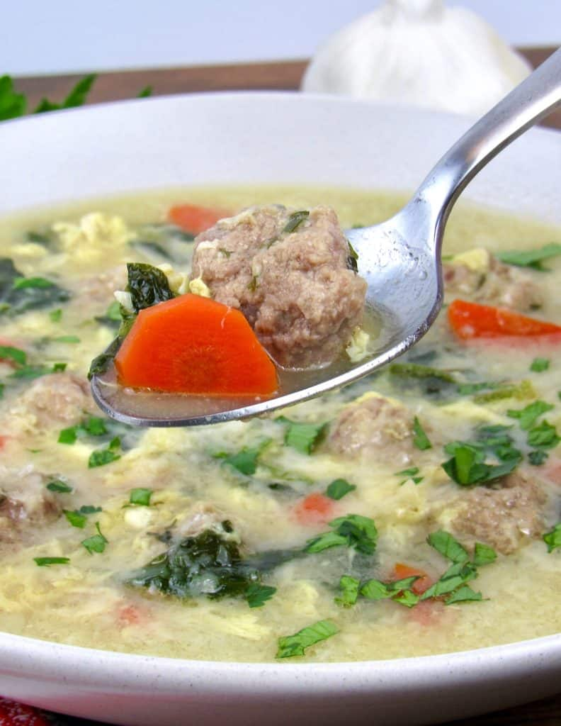 Keto Italian Wedding Soup with spoon holding up some