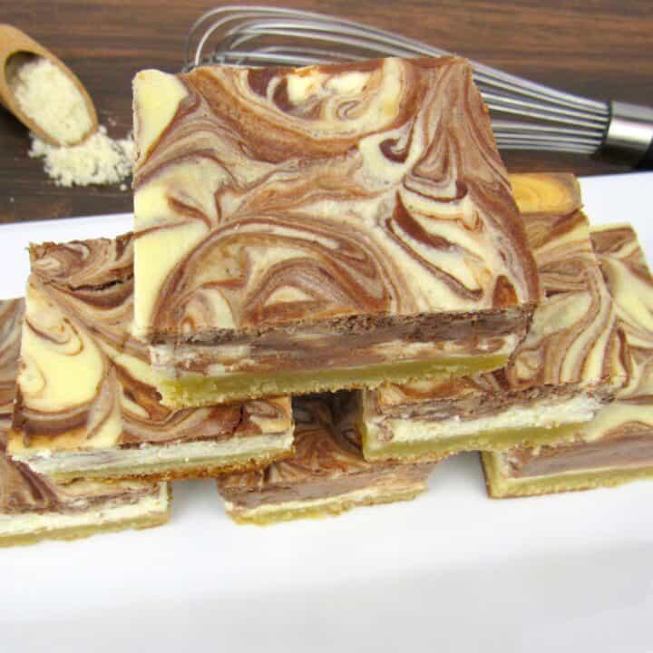 vanilla and chocolate swirl cheesecake slices stacked up