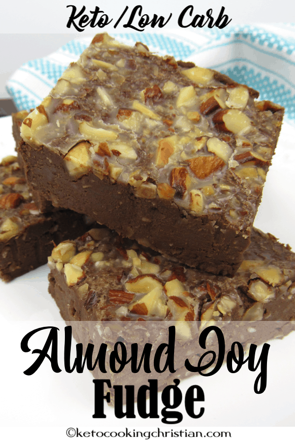 Almond Joy Fudge cut into squares stacked on a plate