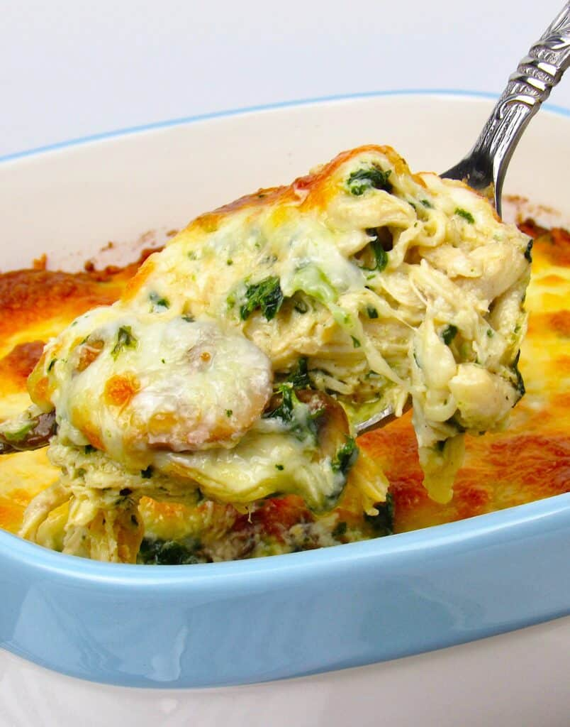 closeup of Chicken Alfredo Casserole with spoonful