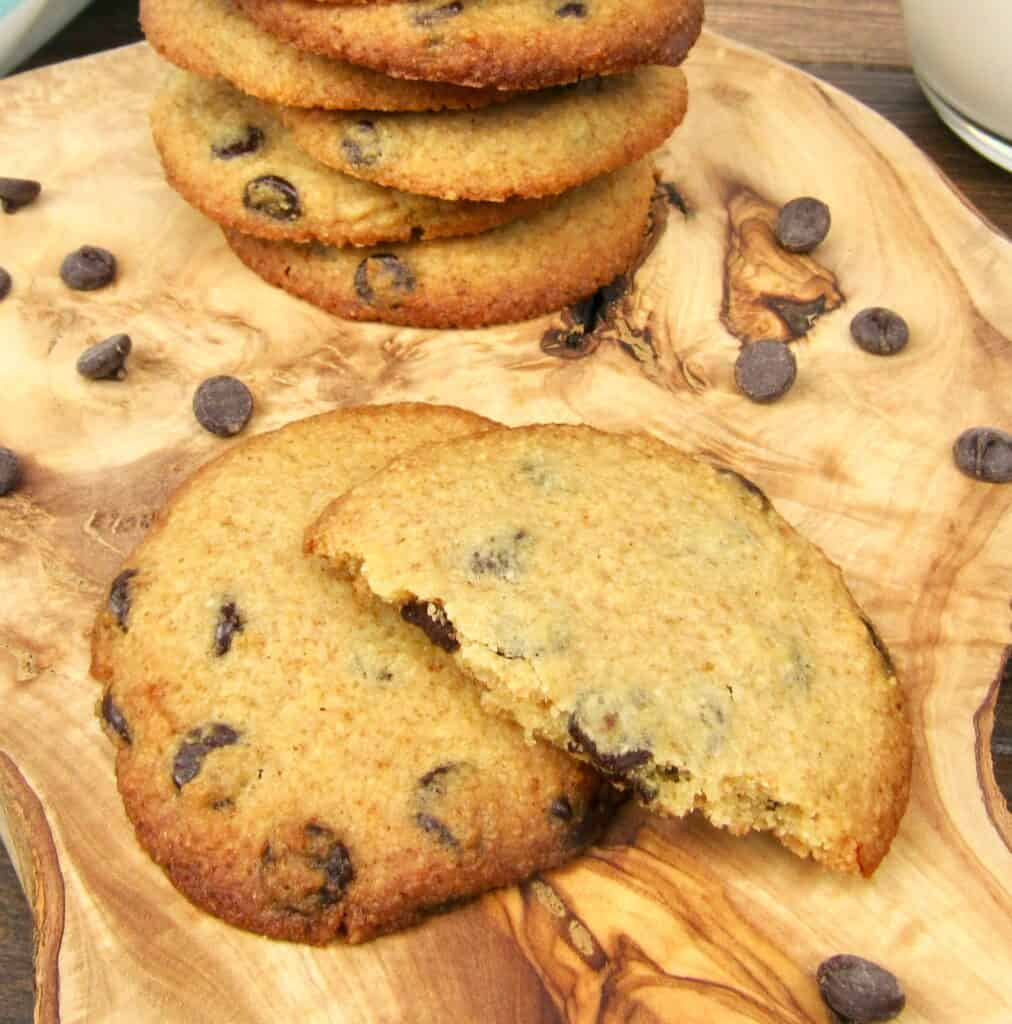 broken chocolate chip cookie on cutting board