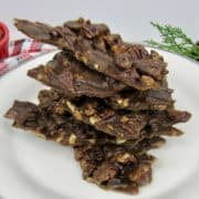 closeup of Keto Pecan Praline Bark stack on plate