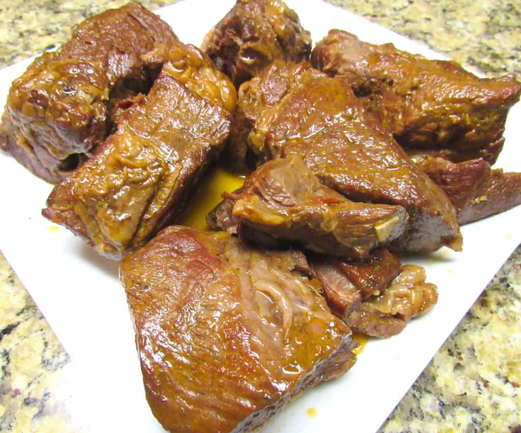 closeup of instant pot roast chunks on white plate