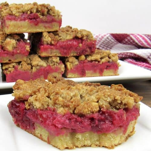 cranberry walnut crumble bars on white plate